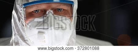 Male Doctor In White Scrubs Portait On Mood Background. Medical Individual Protection Means Concept