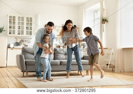 Happy Family Playing Funny Game Having Fun Together.
