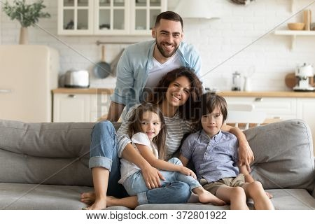 Close Up Portrait Picture Of Happy Young Family Of Four People.