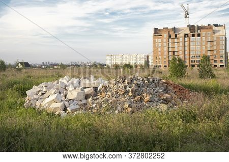 View On Construction Place With Dirt Land And Unfinished Residential Houses