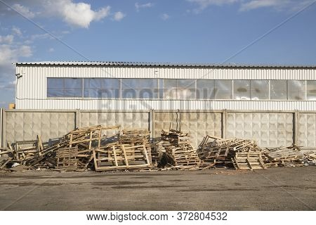 Used Wooden Pallets Are Lumber Near Factory Backyard