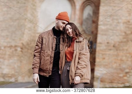 Beautiful Tourist Couple In Love Walking On Street Together. Happy Young Man And Smiling Woman Walki