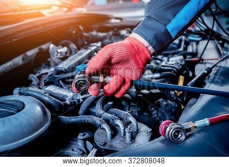 Servicing Car Air Conditioner. Service Station. Car Service