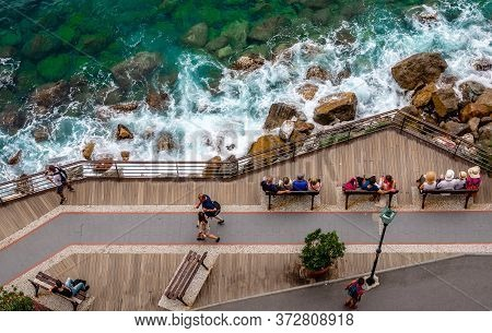 Monterosso Al Mare / Italy - May 28 2018: People Killing Time By The Sea. View From Above.