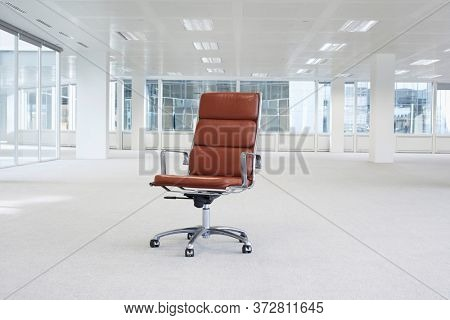 Swivel chair in empty office space