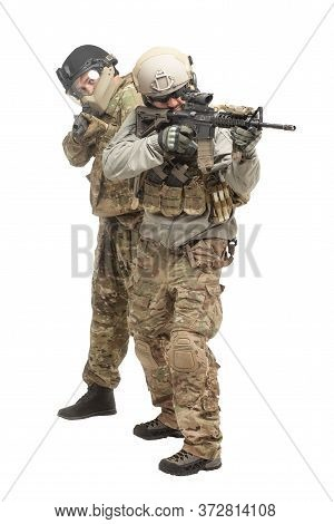 American Special Forces. Two Soldiers In Military Equipment With Guns Attack On A White Background,