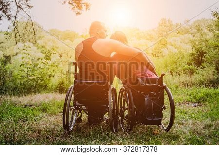 Handicapped Couple Resting In The Forest Near Lake.