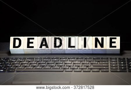 Deadline Word Written On Wood Block. Deadline Text On Wooden Table For Your Desing, Concept.