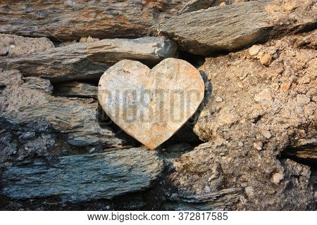 Heart Shape Of Rock Between Stones Between Dust And Soil