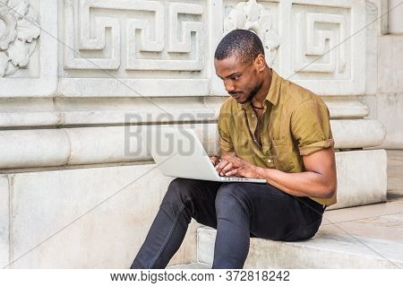 Young African American College Student Studying In New York City, Wearing Green Short Sleeve Shirt,