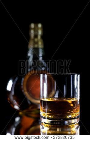 An Imposing And Beautiful Bottle Of Whiskey On Black Background.