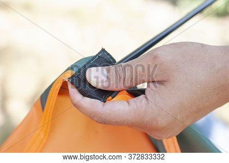 Hand Of Tourists Are Wearing Tent Poles To Pitch A Tent For Camping Tonight.