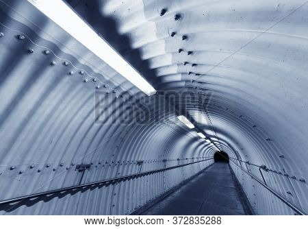 Empty Pedestrian Tunnel At Night. Architecture Abstract Background