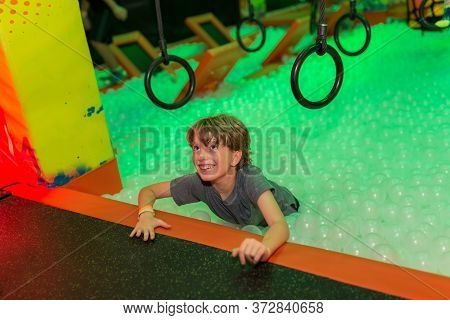Cute Boy Doing An Indoor Obstacle Course
