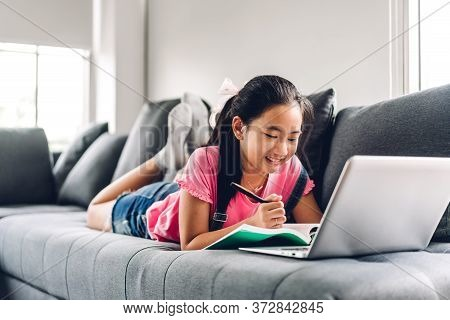 School Kid Little Girl Learning And Looking At Laptop Computer Making Homework Studying Knowledge Wi