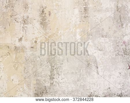 Beige Low Contrast Scratched Smooth Decorative Plaster Concrete Textured Background. Abstract Soft N