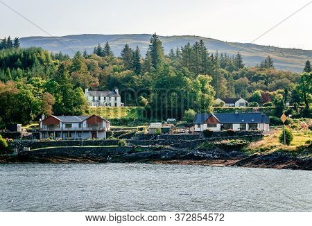Cottages Facing Loch Linnhe In Corran, A Former Fishing Village, Situated On Corran Point, On The We