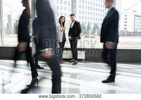 White Collar Workers Going Down Office Corridor During Working Day.