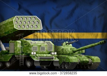 Tank And Rocket Artillery With Summer Pixel Camouflage On The Nauru Flag Background. Nauru Heavy Mil