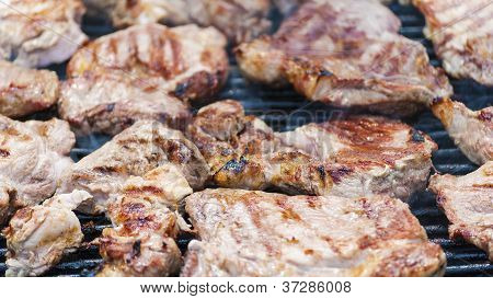 Steaks cooking on barbecue