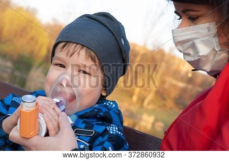 A Small Boy Who Suffering From Illness Bronchial Asthma Getting Treatment With Aerosol Inhaler. Prev