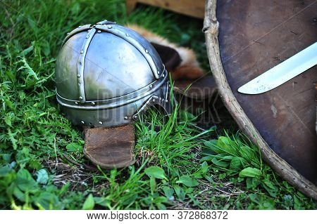 Helmet And Shield On The Grass, Medieval Style