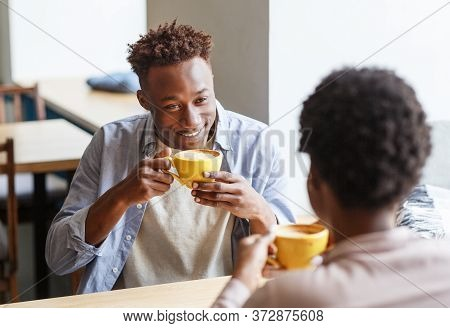 Handsome Black Guy Flirting With His Girlfriend While Drinking Coffee At Cafe