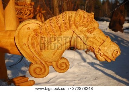 Retro Image. Two Old Wooden Carved Horse's Heads (children's Toy - Horse Head On Stick) Are Laying O
