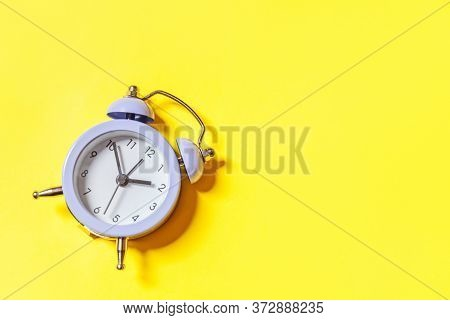 Simply Minimal Design Ringing Twin Bell Vintage Classic Alarm Clock Isolated On Yellow Background. R