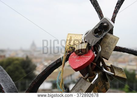Rome, Italy - October  12, 2018: Lovers Padlocks On A Bridge. View From The Pincian Hill In Rome, It