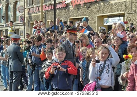 Russia, St. Petersburg 09,05,2013 Happy Spectators At The Wwii Victory Parade