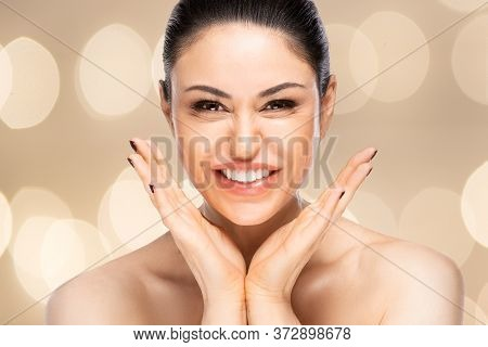 Cheerful Beautiful Woman Face Portrait Close Up. Beauty Skin Care Concept. Over Blurred Background
