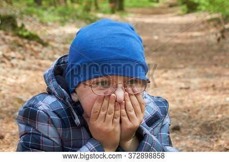 The Boy Covered His Mouth With His Hands, Boy In Glasses Covers His Face With His Hands In Autumn