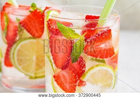 Detox Sassy Water With Strawberry And Lime In Glasses. Healthy Eating Concept.