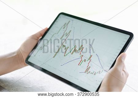 Business Woman Hand Holding Digital Tablet Computer With Graph Of Binary Option For Trading Platform