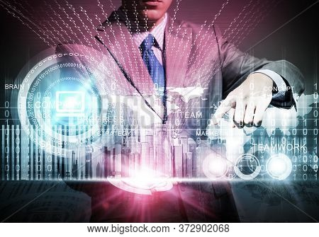Businessman Touching Colorful Hologram Of Modern City. Architect Presenting Construction Project Of