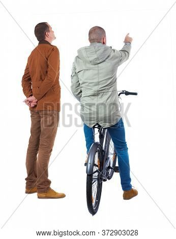 Back view of two man on a bicycle in winter jacket. Rear view people collection. backside view of person. Isolated over white background.