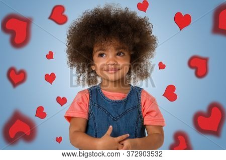 Childhood And People Concept-portrait Of Smiling African American Little Girl, Over Colored Backgrou
