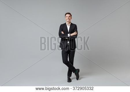 Cheerful Young Business Man In Classic Black Suit Shirt Posing Isolated On Grey Wall Background Stud