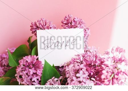 Inscription Thank You On German On A White Gift Card In A Beautiful Bouquet Of Lilac Flowers