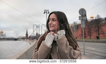 A Positive Girl Walks Along The Promenade And Laughs. Person Spinning In A Circle. Smiling Woman Wal