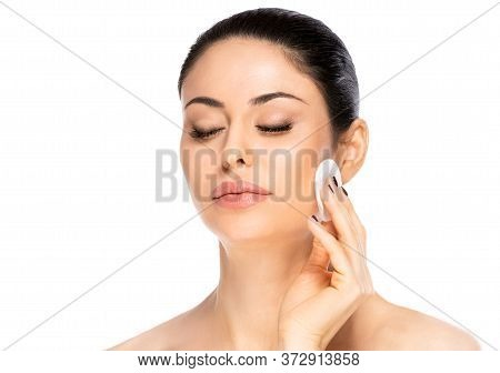 Beautiful Brunette Woman With Cotton Pad, Isolated. Health And Beauty Concept