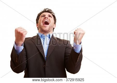Cheering businessman cheerfully clenches his fists