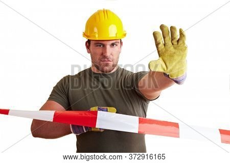 Construction worker stands behind a barrier tape with his hand outstretched