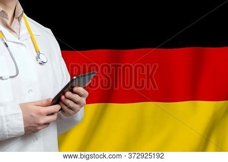 Federal Republic Of Germany Healthcare Concept With Doctor Man On Flag Background. Medical Insurance