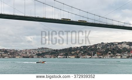 Istanbul, Turkey - October 2018: Coast Guard Boat In Bosphorus Strait Sailing Under 15 July Martyrs