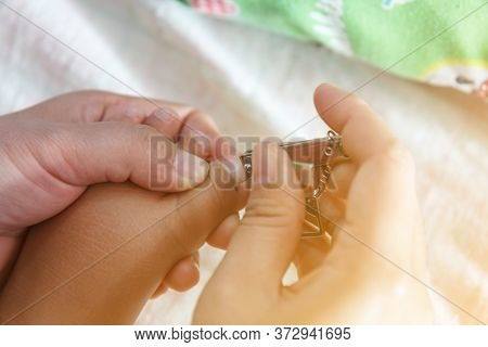 Thai Mother Blur Motion Cutting Fingernails Baby Boy With Scissors,mother Care Is Most Important For