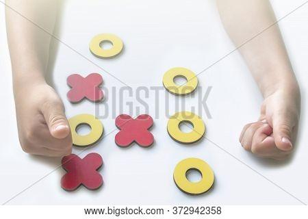 Kid Tic-tac-toe Wood Board Game On White Background. Child Won The Game. Developmental Game. Family