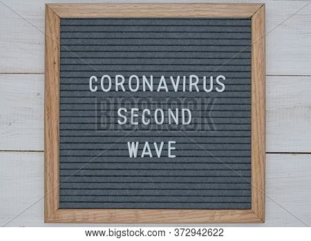 Grey Felt Board With Text In English Coronavirus Second Wave. The Concept Of The Second Wave Covid-1