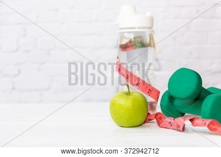 Diet Health Food And Lifestyle Health Concept. Sport Exercise Equipment Workout  and Gym Background